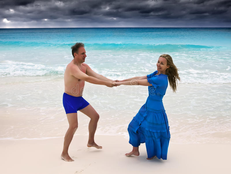 The loving couple is turned on the seashore stock images