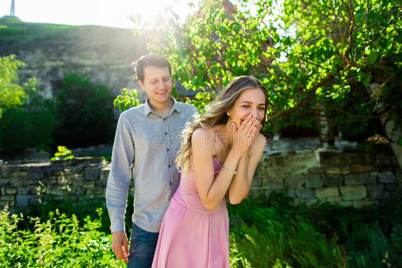 Loving couple under a big tree in the park in summer.  stock image