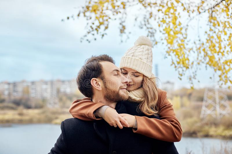 Loving couple walking in Park in autumn hugs and kisses. Autumn stock photo