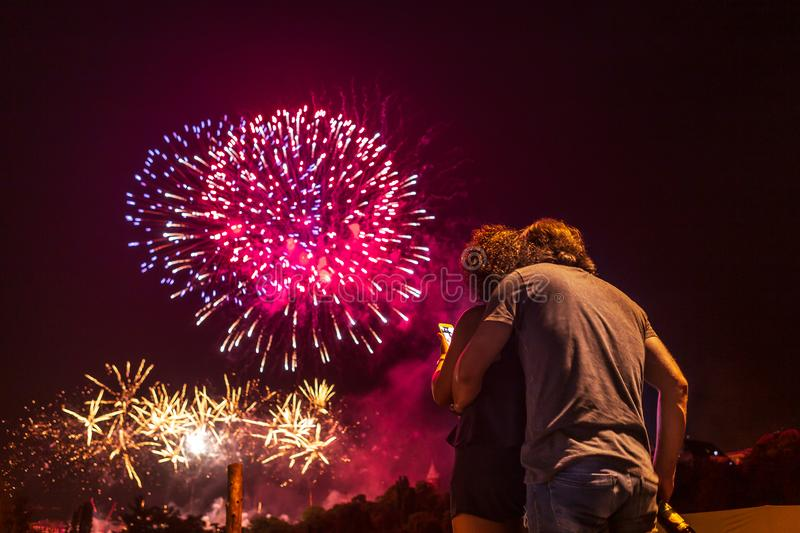 Loving couple watching fireworks royalty free stock photography