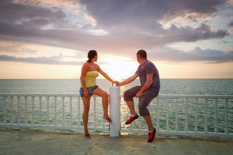 Loving Couple Watching Sunset At The Sea Royalty Free Stock Photo