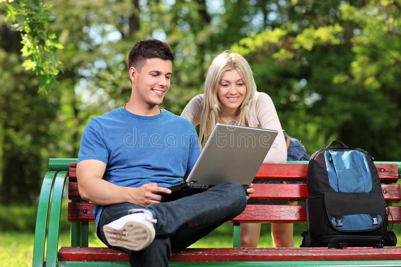 Download A Loving Couple Working On A Laptop Stock Photo - Image: 24758450