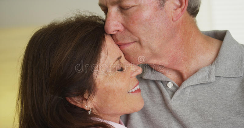 Loving elderly couple holding each other royalty free stock photos