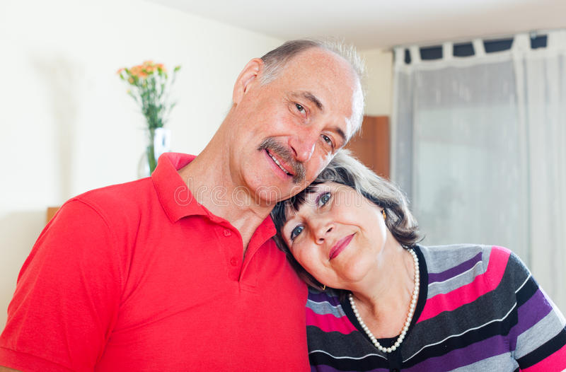 Loving elderly couple in home royalty free stock image