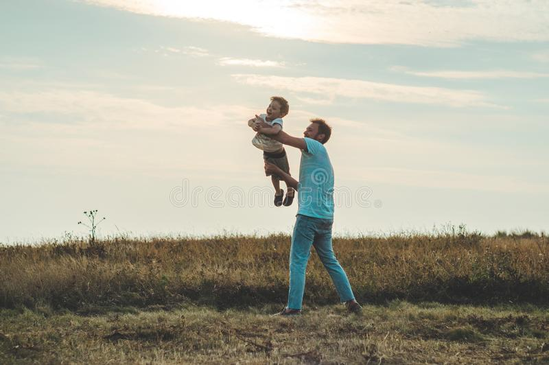 Loving family. Father and his son baby boy playing and hugging outdoors. Happy dad and son outdoors. Concept of Father`s day. Loving family. Father and his son stock photography