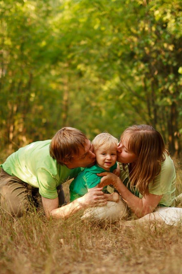 Loving family kiss stock photos