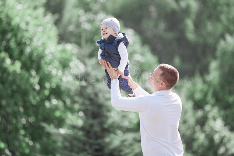 Loving father and son on a walk in the spring Park. The concept of parenting royalty free stock photography