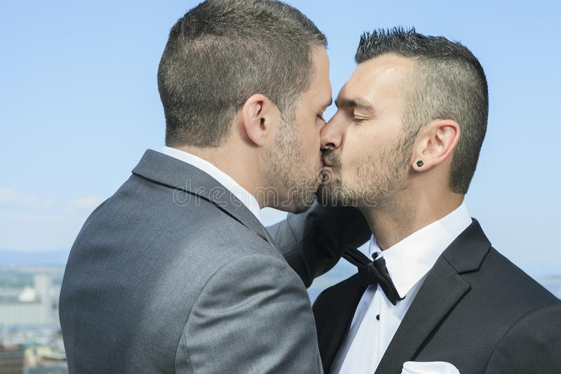 Loving gay male couple on their wedding day stock image