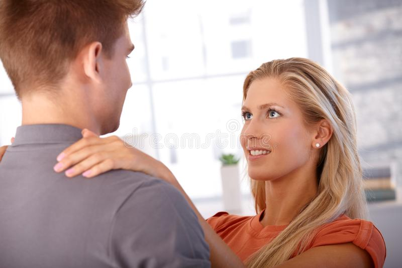 Loving girlfriend looking at boyfriend stock photos