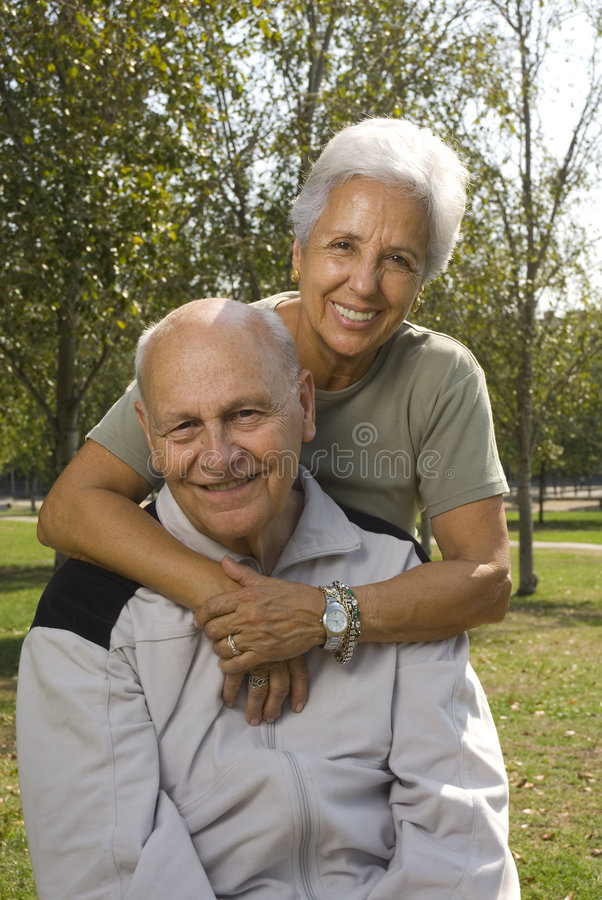 Loving, handsome senior couple stock photo