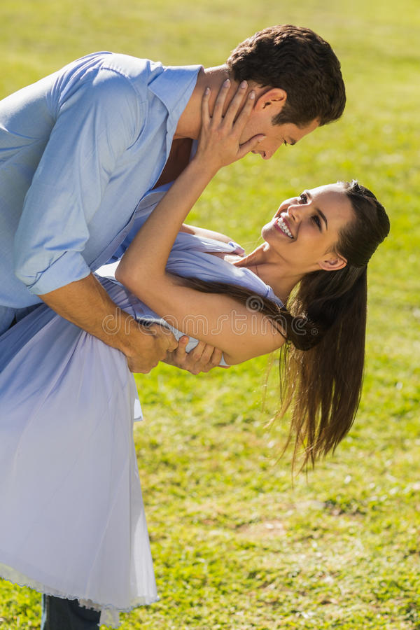 Loving and happy couple dancing in park royalty free stock photos