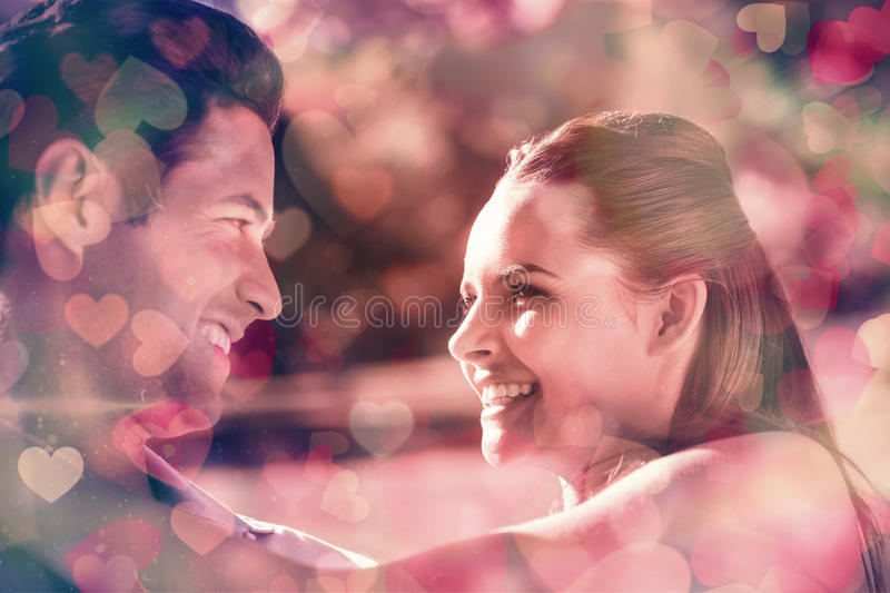 Loving and happy couple looking at each other at park royalty free stock photography