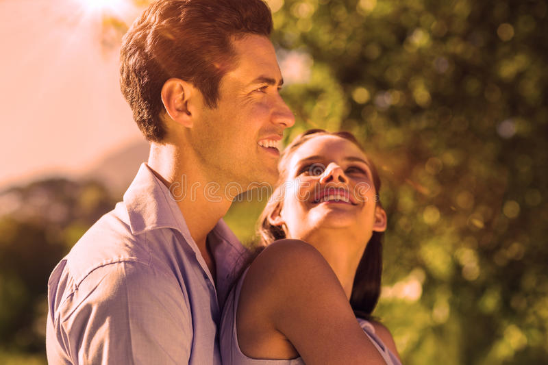 Loving and happy young couple at park stock image