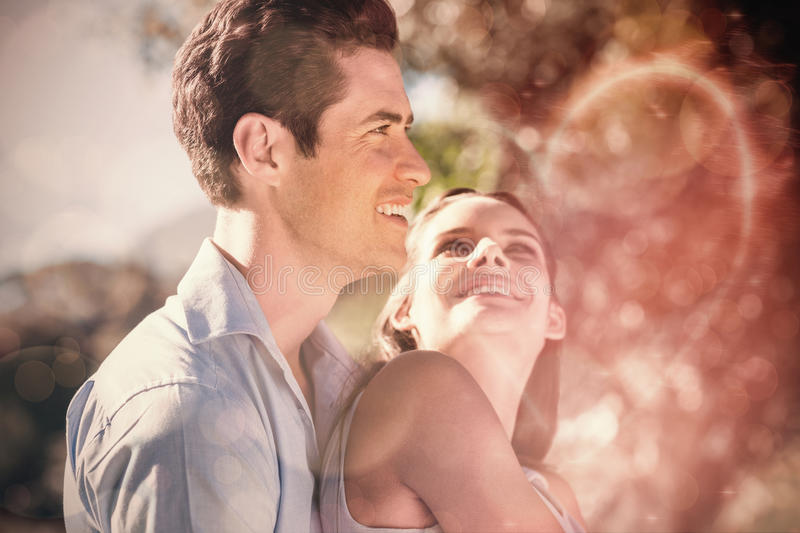 Loving and happy young couple at park stock photography