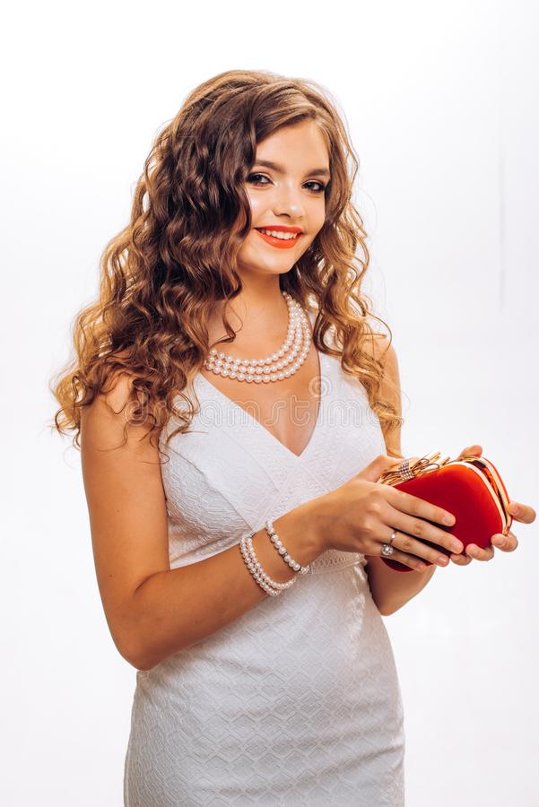 Loving her new style. Woman of fashion in white wedding dress. Young woman with stylish makeup and long curly hair. Pretty girl with beauty look. Fashion stock photos