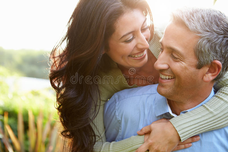 Loving Hispanic Couple In Countryside. Looking At Each Other Smiling stock photos