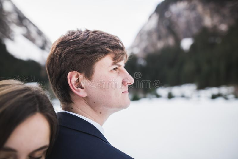 Loving husband and woman on the background of the mountains. Loving couple emotionally spends time stock photography