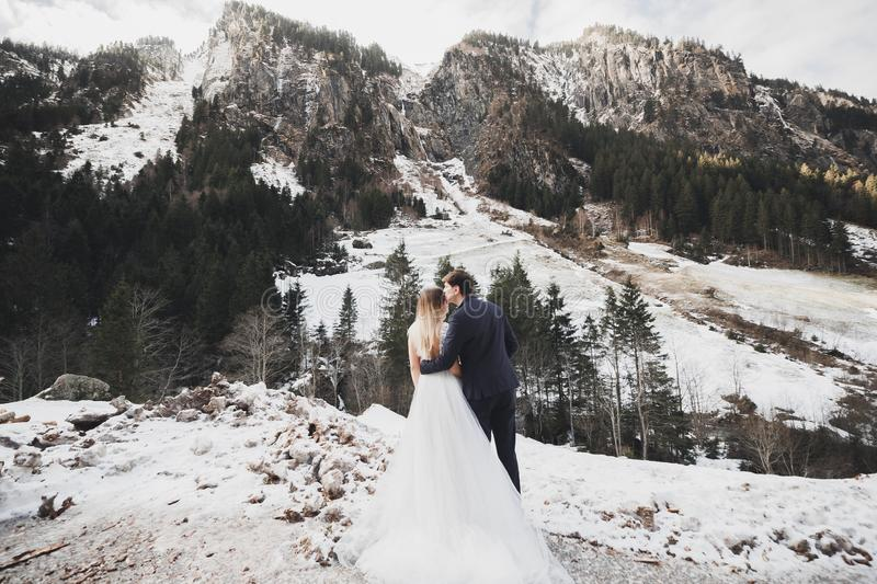Loving husband and woman on the background of the mountains. Loving couple emotionally spends time stock image