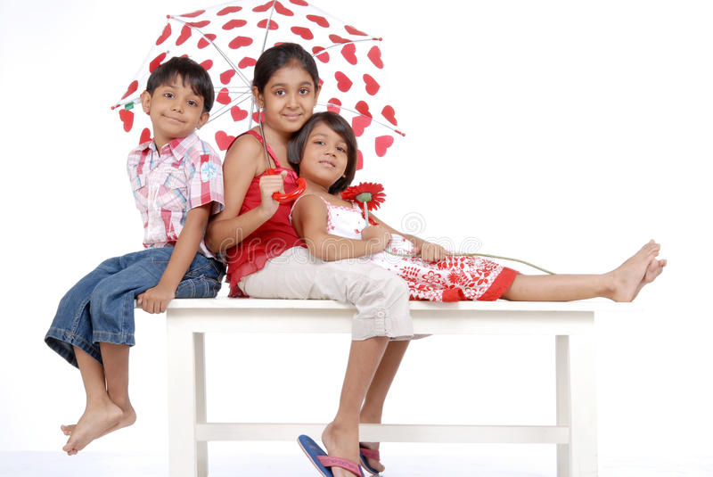 Loving indian twins with elder sister stock photography