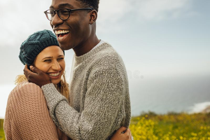 Loving interracial couple spending time together stock image