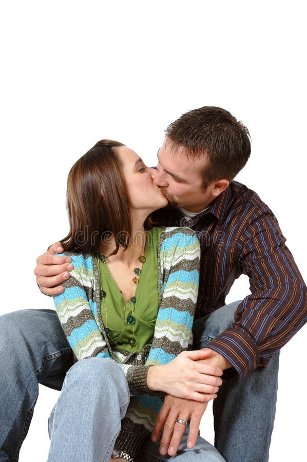 Loving Kiss. Happy couple give each other a kiss royalty free stock photos