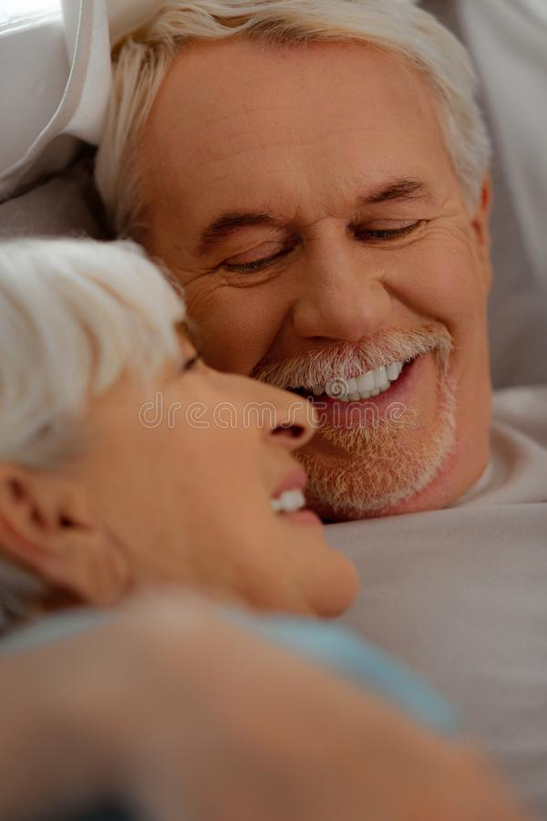 Face-portrait of white-haired vigorous man looking at silver-haired beautiful wife stock photography