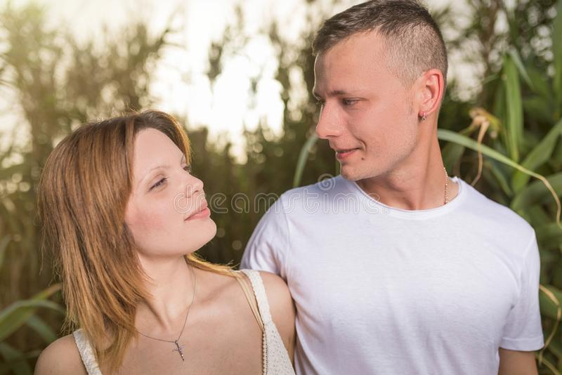 Loving man and happy woman in a spring blooming park stock photos