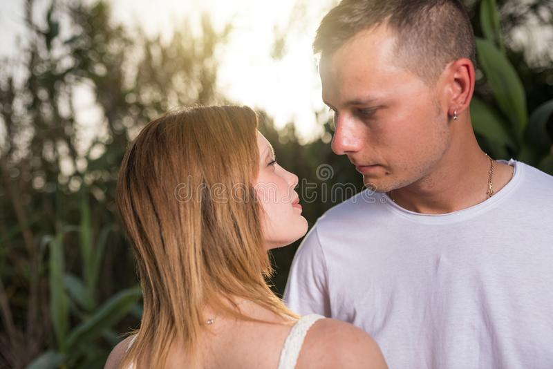 Loving man and happy woman in a spring blooming park. Loving men and happy women in a spring blooming park. Happy mature couple in love embracing outdoor stock photography