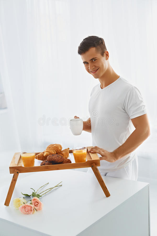 Loving man with romantic breakfast stock photography