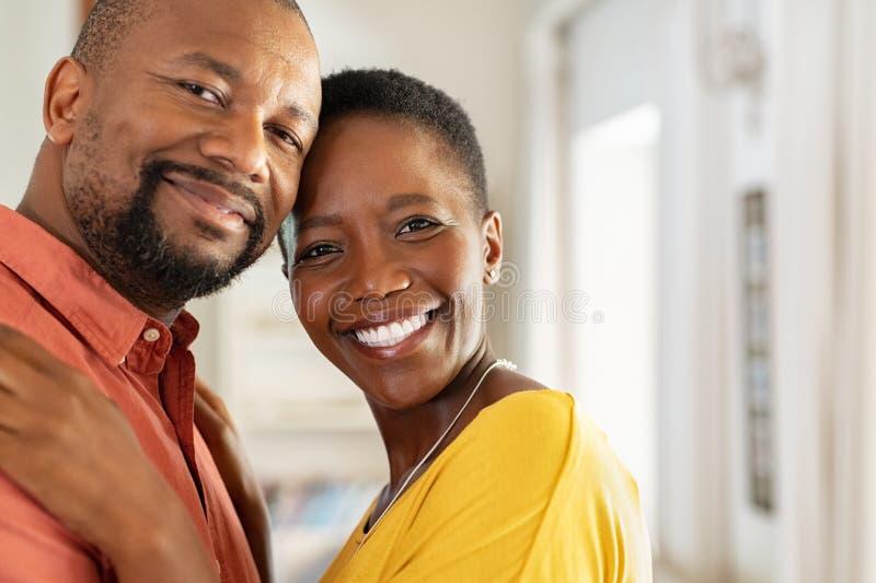Loving mature couple looking at camera stock photo