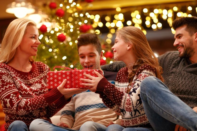 Mother giving her excited daughter Christmas presents stock image