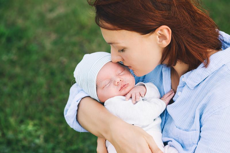 Loving mother with her newborn baby on her arms. royalty free stock photo