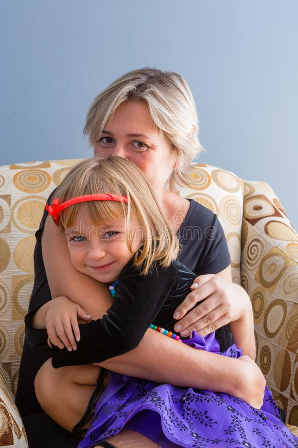 Loving mother hugging her cute little daughter royalty free stock photos