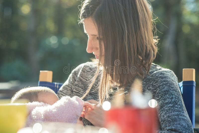 Loving mother with her tiny baby girl stock photo