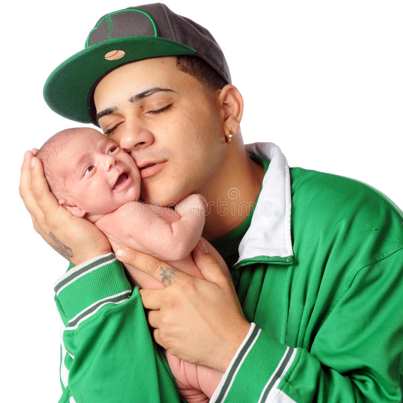 Loving New Dad. A young Hispanic dad loving on his newborn son. Isolated on white royalty free stock photos