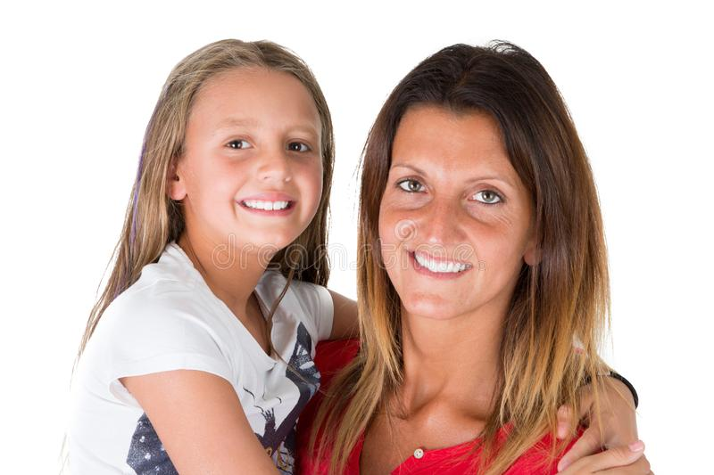 Loving pretty mother and her cute beauty daughter child girl hug on white background stock photo
