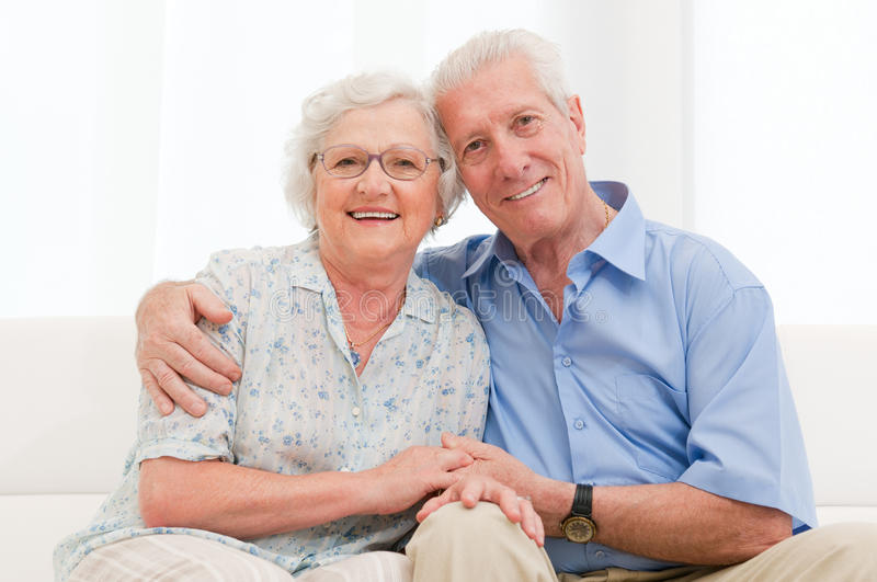 Loving senior couple. Happy smiling senior couple embracing together at home