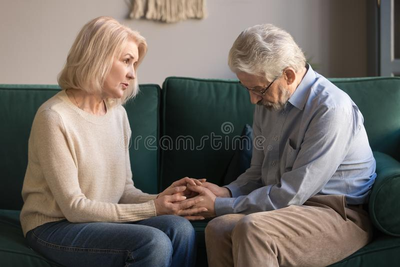 Loving mature wife comfort support upset senior husband royalty free stock photos