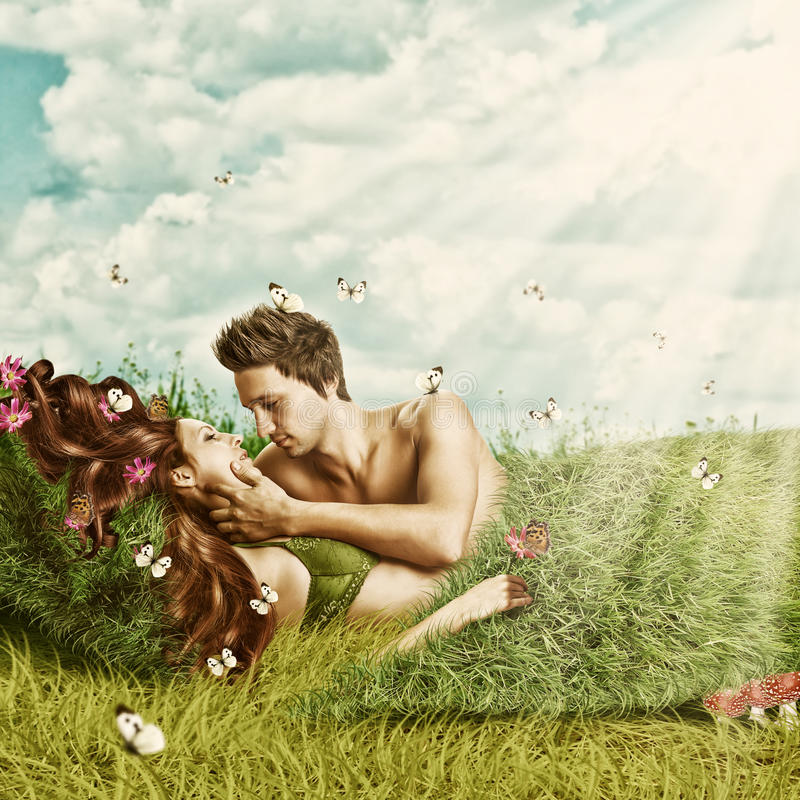 Loving sexy couple lying in bed of grass