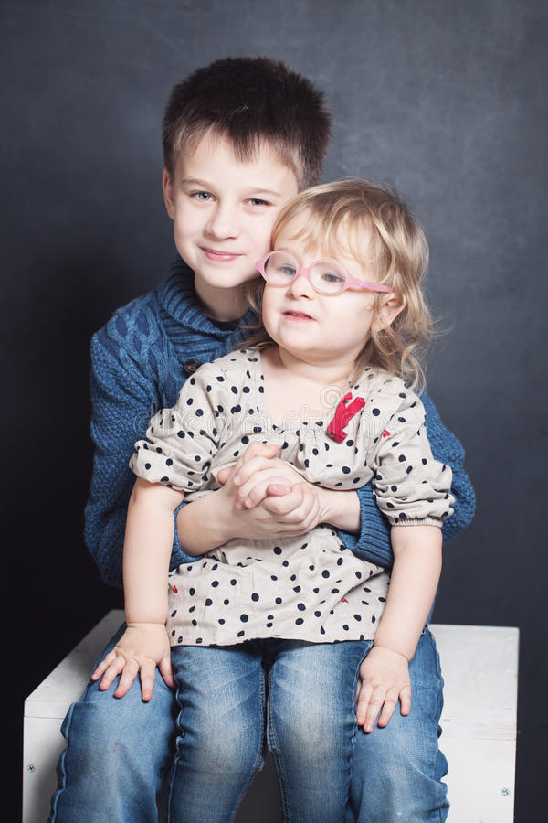 Loving Sibling. Smiling Brother and Sister royalty free stock image