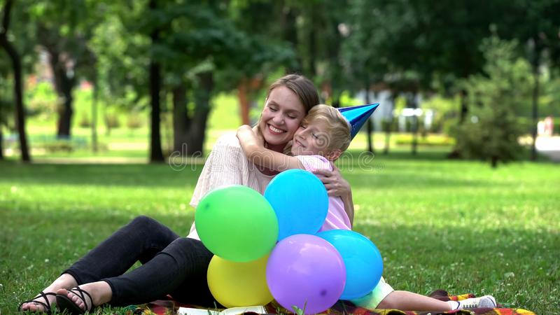 Loving son congratulating mom on birthday, single parenting and grateful child stock images