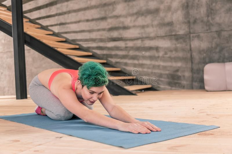 Woman loving sport stretching after intensive fitness in gym royalty free stock photos