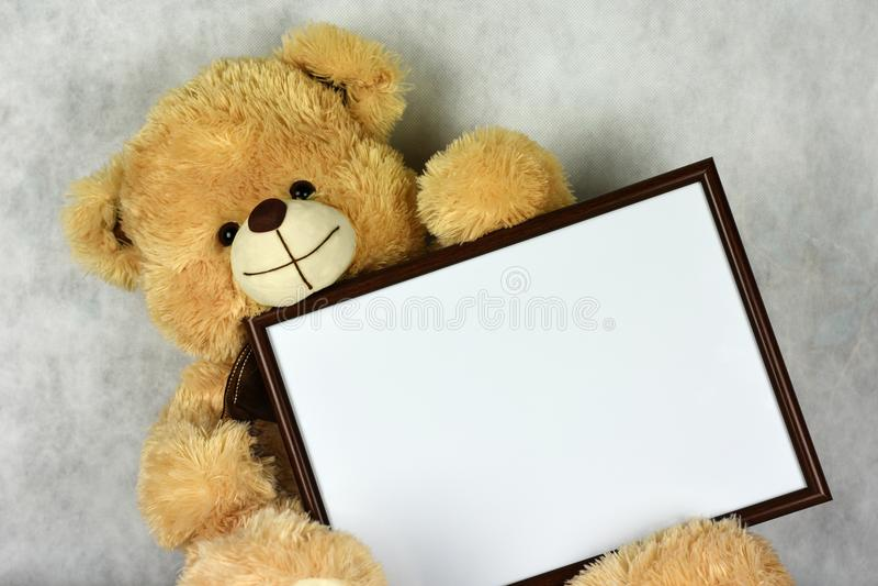 A Loving Teddy Bear Keeps A Frame With A Heart On The Day Of Saint ...