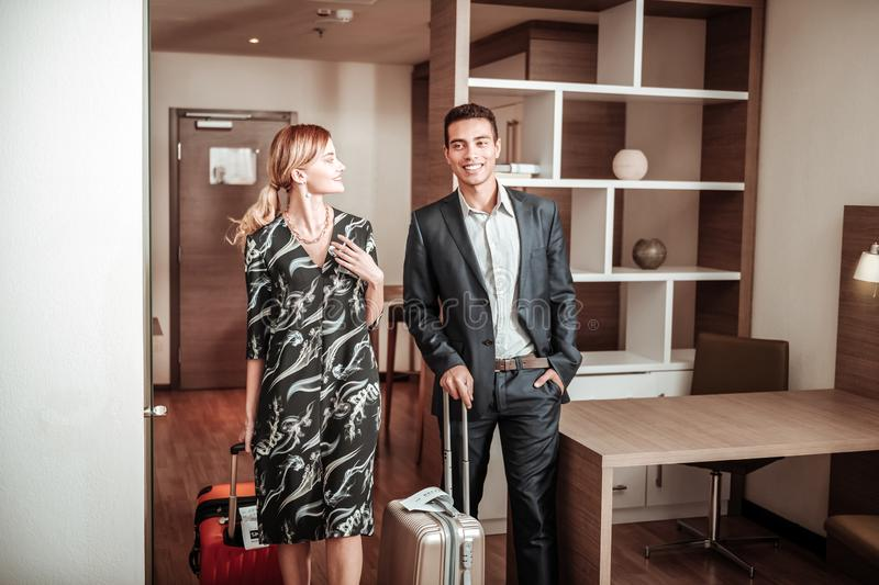 Loving wife accompanying her husband during business trip royalty free stock photography