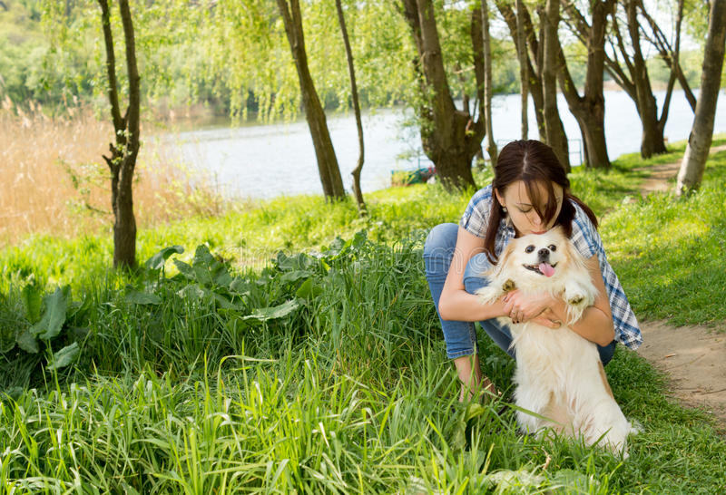 Loving woman hugging her little dog royalty free stock photography