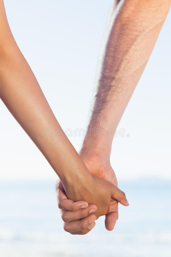 Download Loving Young Couple Grasping Hands Stock Image - Image of clear, race: 33054323