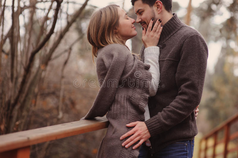 Loving young couple happy together outdoor on cozy warm walk in autumn forest royalty free stock image