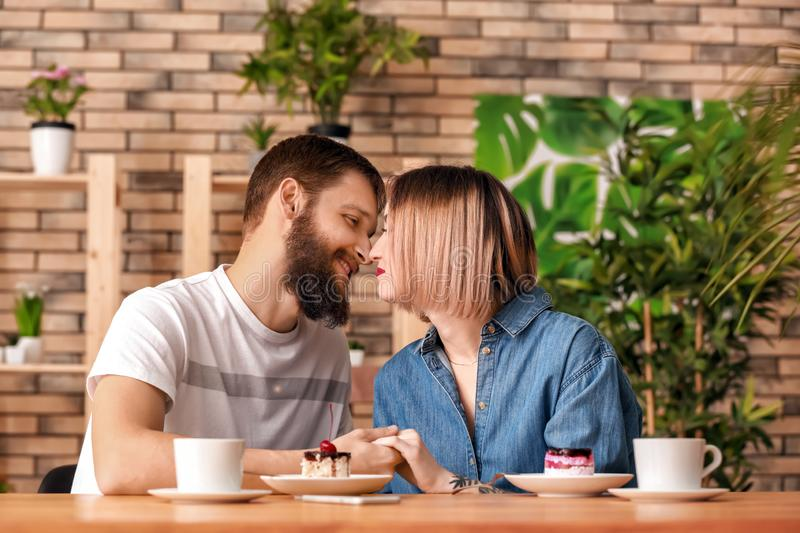 Loving young couple during romantic date in cafe stock photo