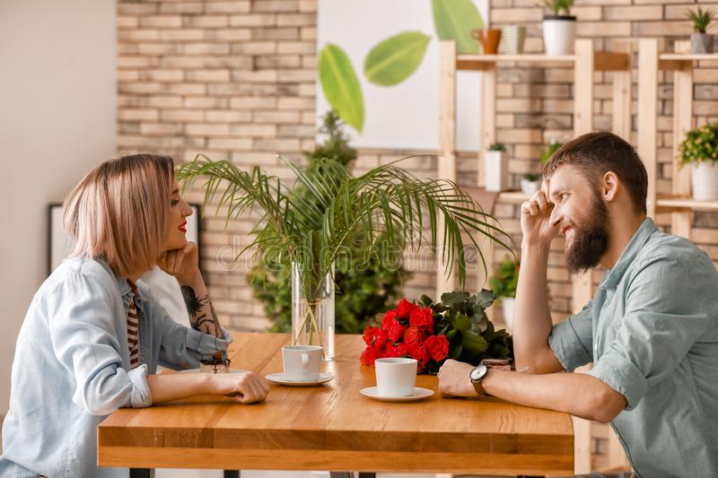 Loving young couple during romantic date in cafe royalty free stock images