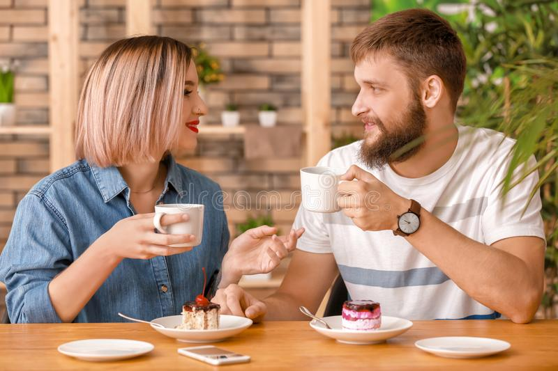 Loving young couple during romantic date in cafe royalty free stock photo
